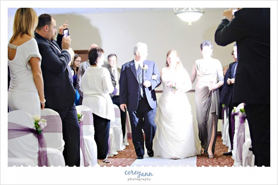 A perfect example of how a guests' flash at your wedding (phone or camera) can and WILL ruin the shot ... there is NO amount of editing to fix this.  Read the article here: http://www.huffingtonpost.com/bridal-guide/why-you-might-want-to-con_b_3331528.html