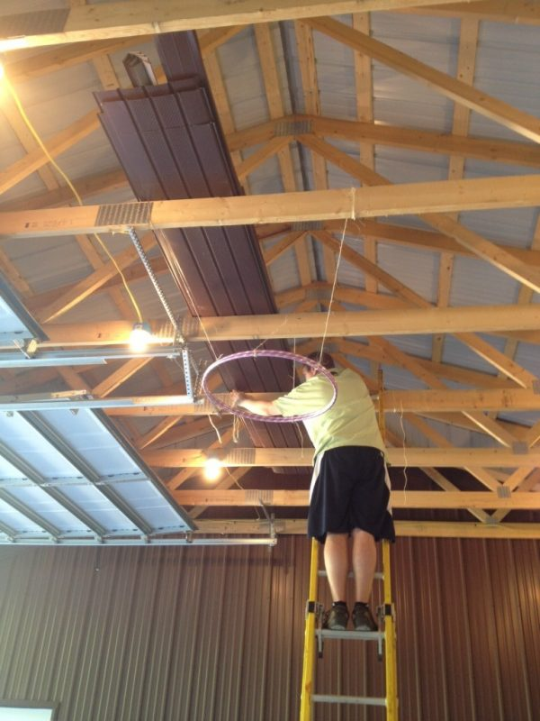 How this whole thing starts ... 2 hula hoops taped together (for strength) and tied to the center beam ... where each piece will eventually be tied to from the center of the barn.
