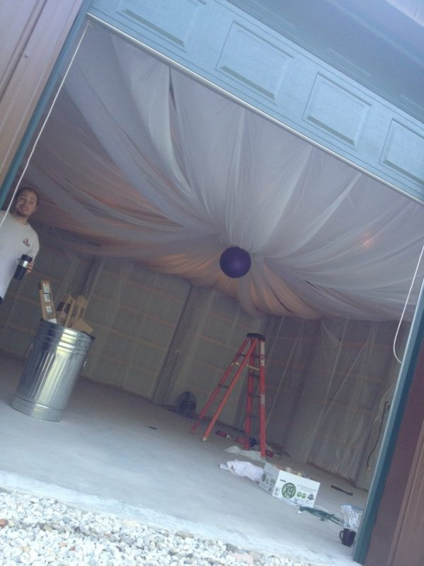 The ceiling and walls are up - and so is the glitter-sprayed paper lantern!