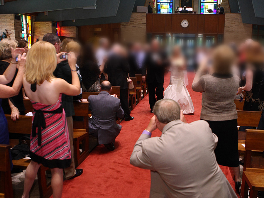 unplugged wedding - wedding guests in aisle at ceremony