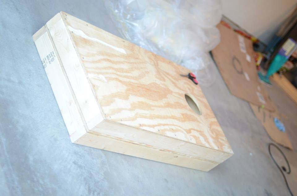 """Our Corn Hole/Bean Bag Toss - Plywood 3/4"""" tops with 2x4s around the bottoms (this is 2 stacked on top of one another) and using a 6inch saw piece, drilled a hole for the bean bags."""