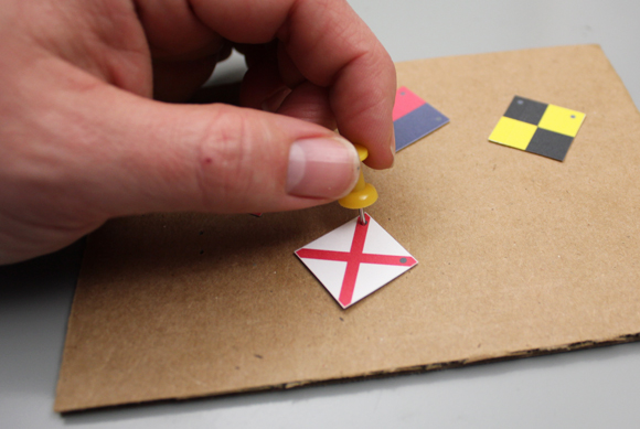 06-punch-holes-with-pin-on-flags