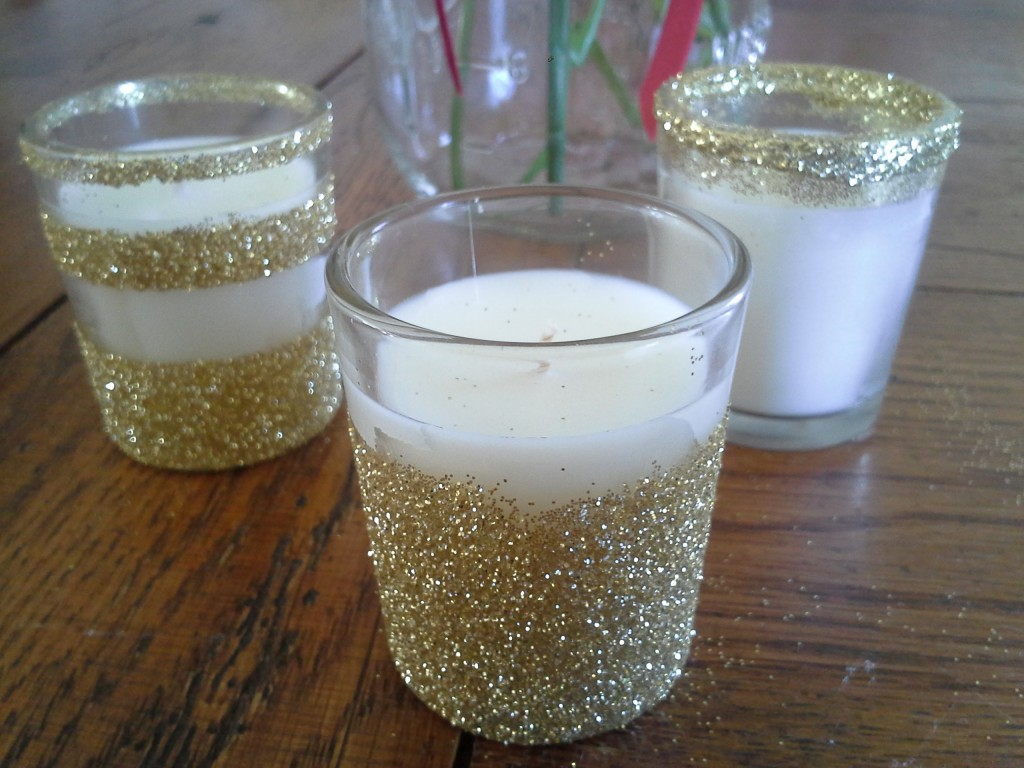 Glitter votives candles are a fun way to spice up your decor without stretching your budget. See how I made my own with just a few supplies!