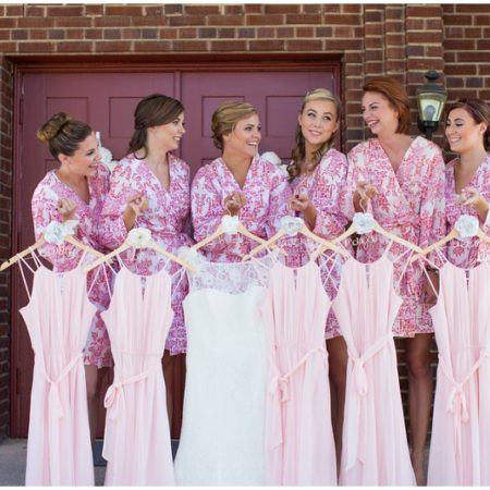 bride and bridesmaids with dresses