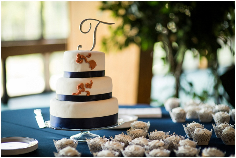 wedding cake with navy and rust accents