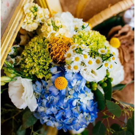 blue hydrangea and yellow flower bouquet