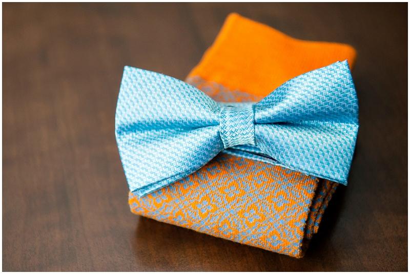 blue and orange groom attire