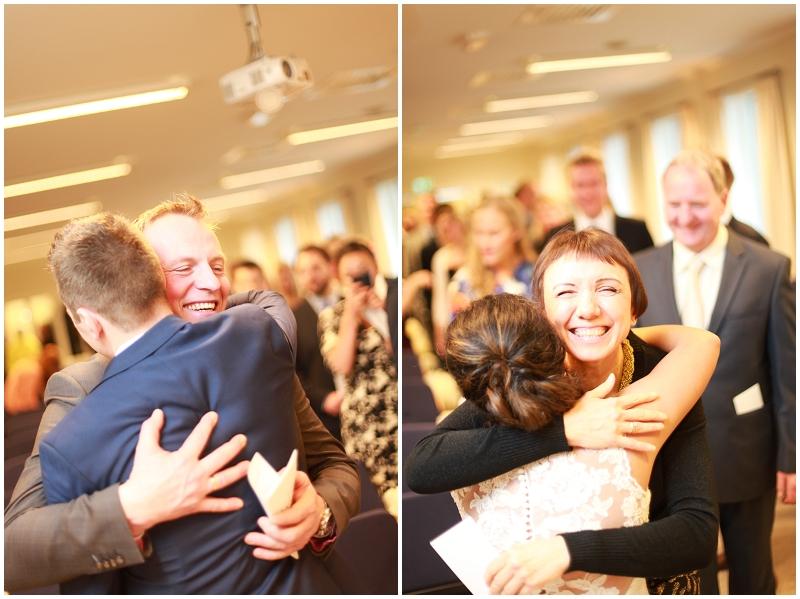 hugging guests after wedding