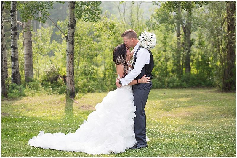 white and black bride and groom attire