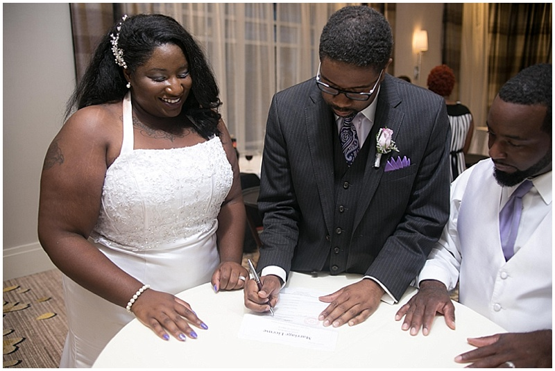 signing marriage certificate