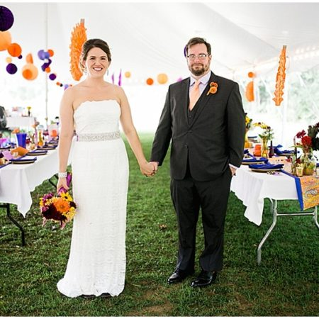 purple and orange wedding reception decor