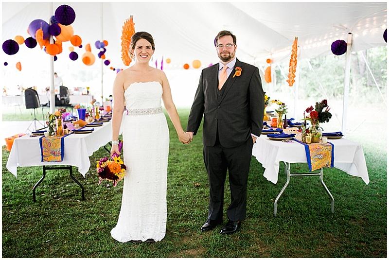 purple and orange wedding reception decor
