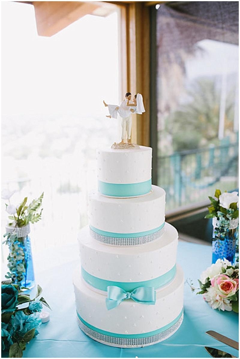 aqua and white wedding cake
