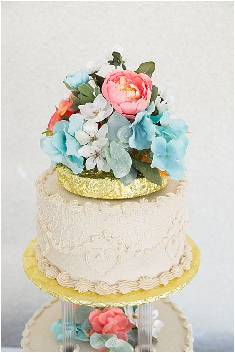 coral and turquoise wedding cake