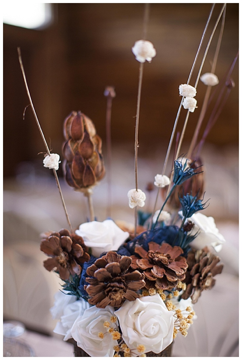 blue flower and pinecone wedding centerpieces