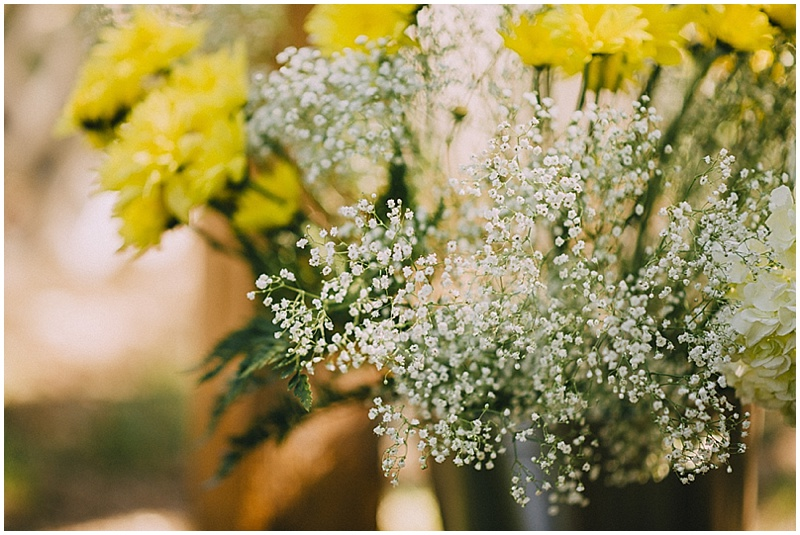 yellow daisy and baby breath flowers