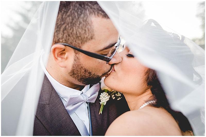 bride and groom kiss photos