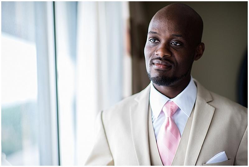 khaki and pink groom attire