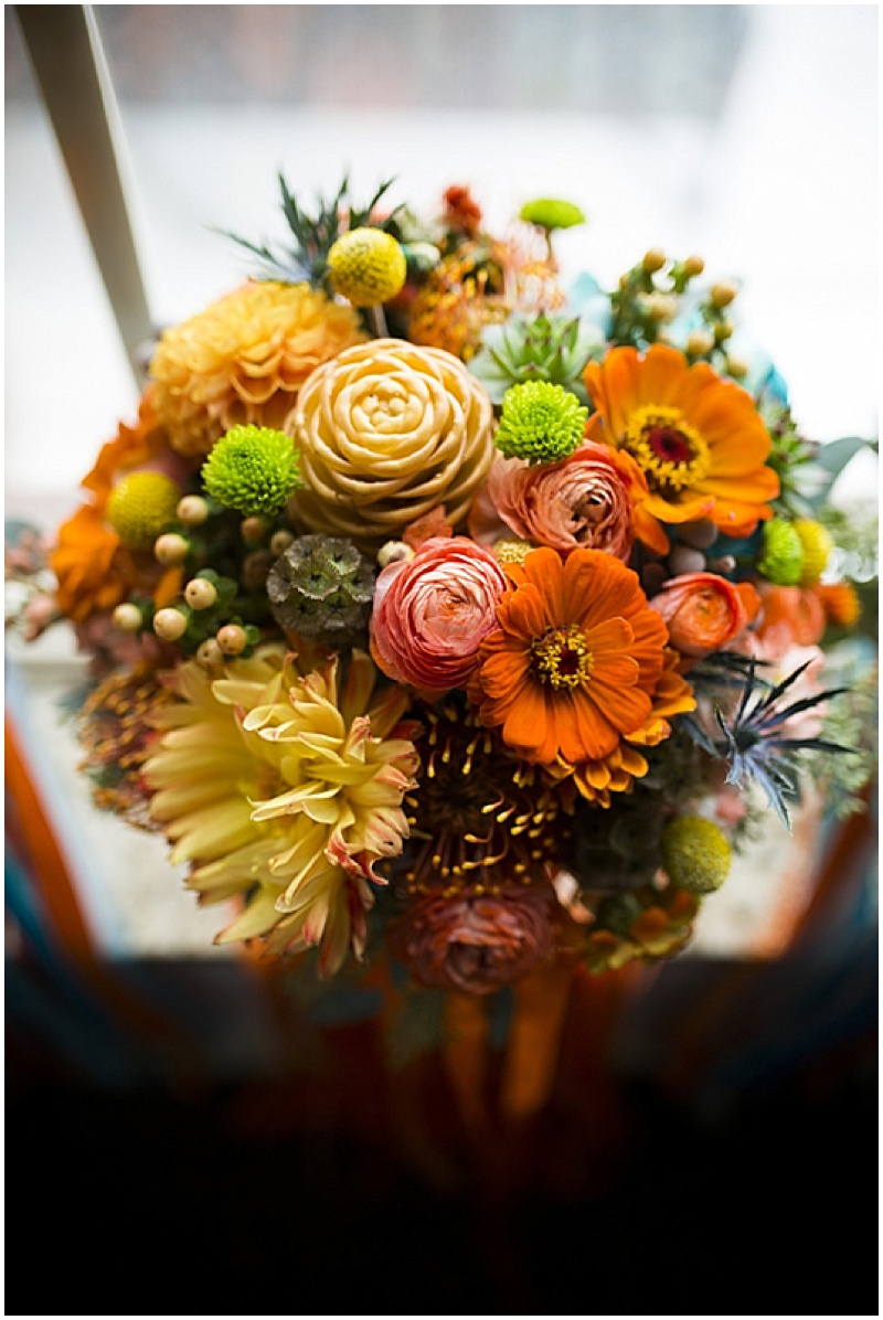 orange and teal wedding bouquets