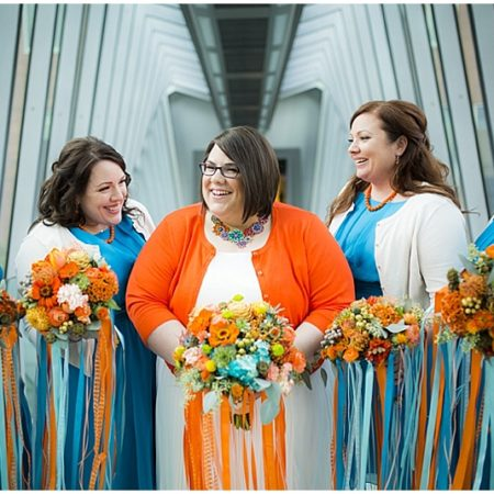 teal and orange wedding attire