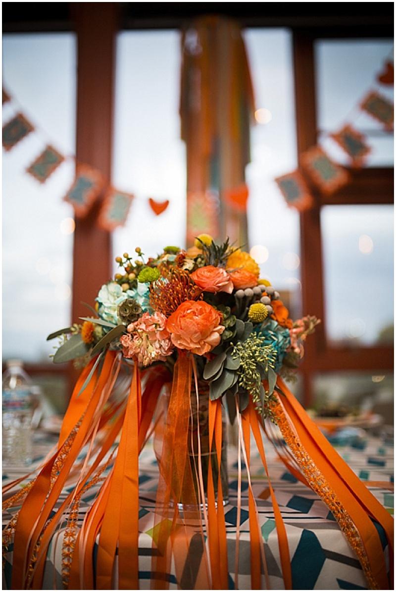 teal and orange wedding flowers