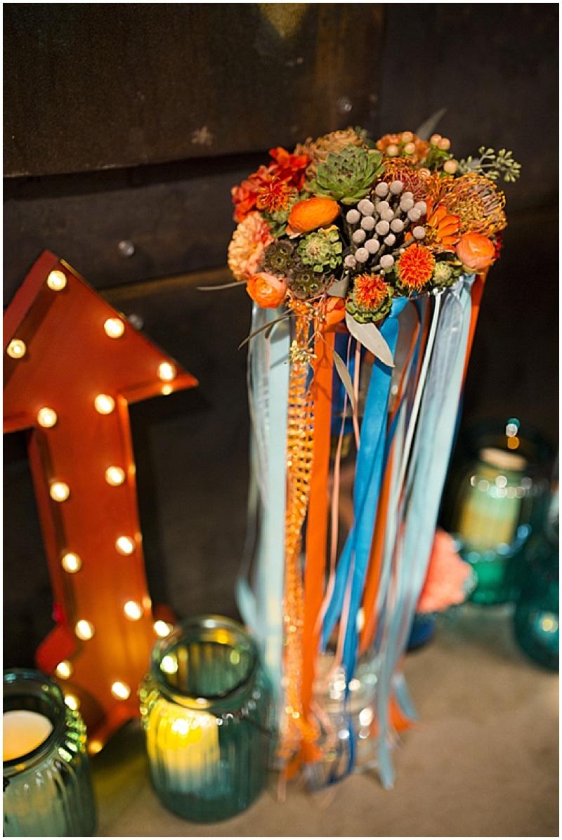 teal and orange wedding reception decor