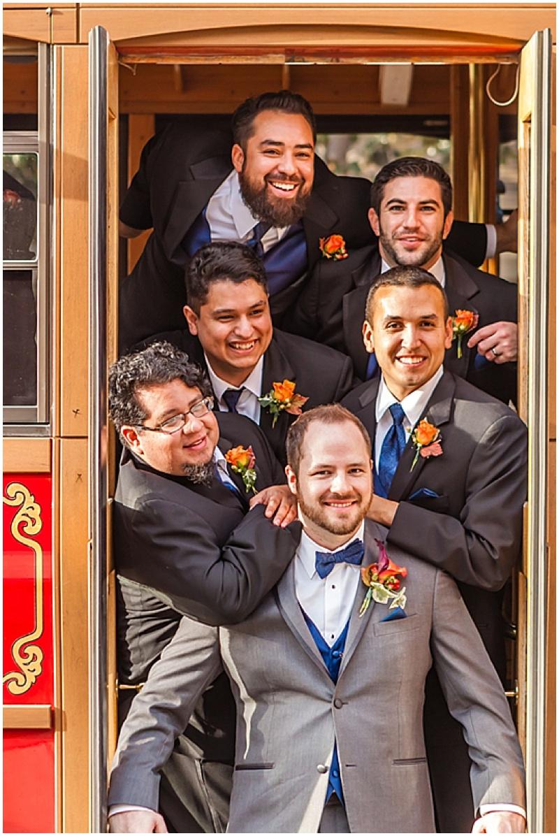 navy and orange wedding attire