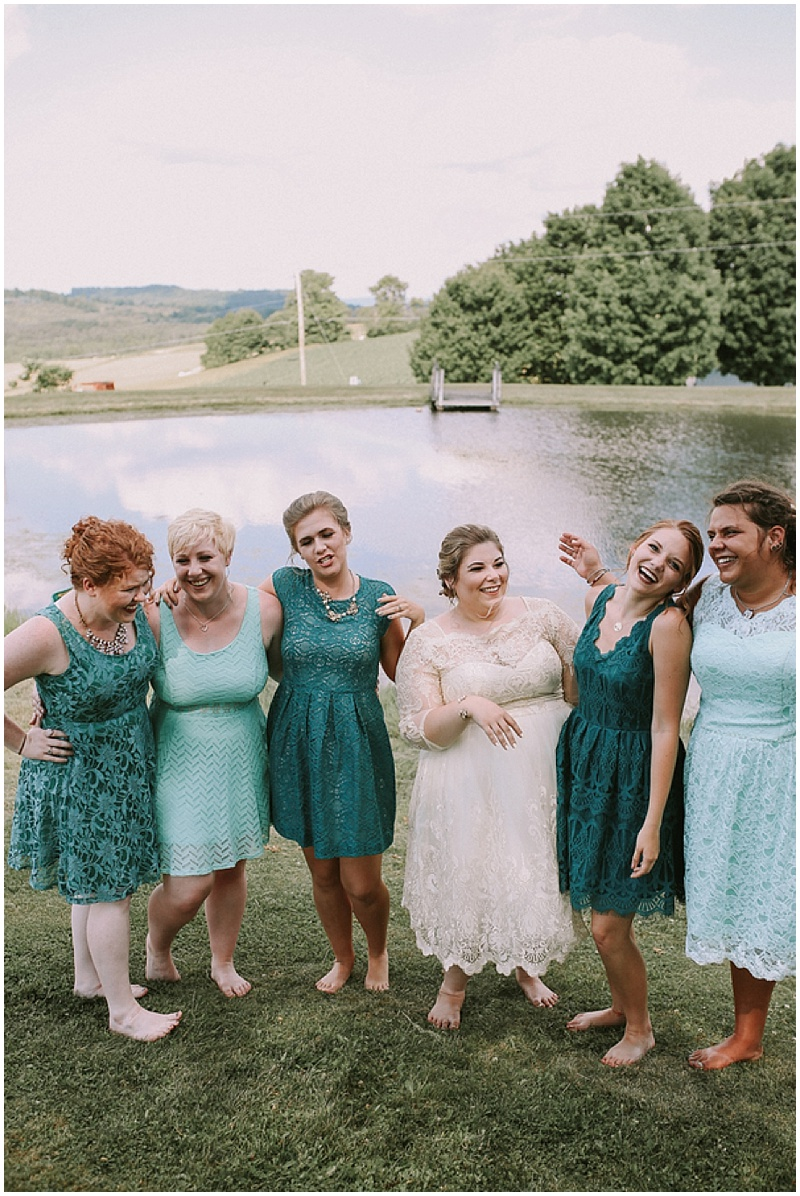 mis-matched teal bridesmaid dresses