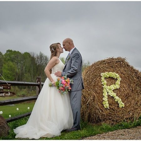 couple wedding photos round hay bale