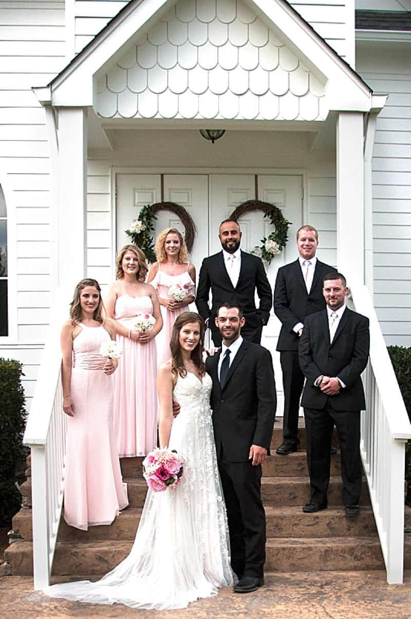 pink and black wedding attire