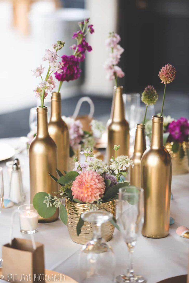 upcycled gold painted wine bottles centerpiece brit jaye
