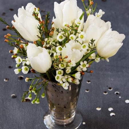 Blooms on a Budget from Somewhere Splendid via Budget Savvy Bride | Arrangement with Tulips and Wax Flowers