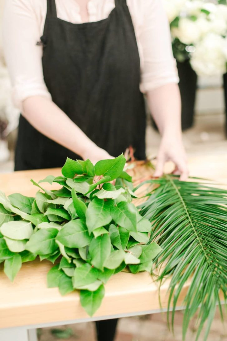 bloom culture flowers - ceremony floral arrangement - step 4 - start with greenery