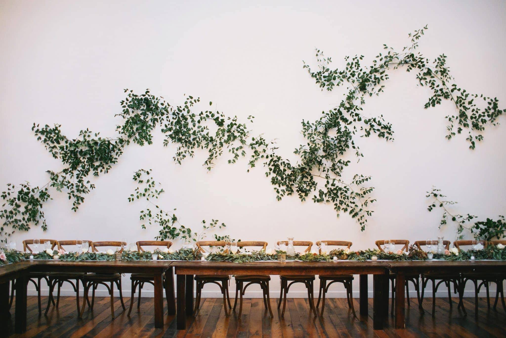 alternative ceremony altar decor ideas | hang greenery on a wall