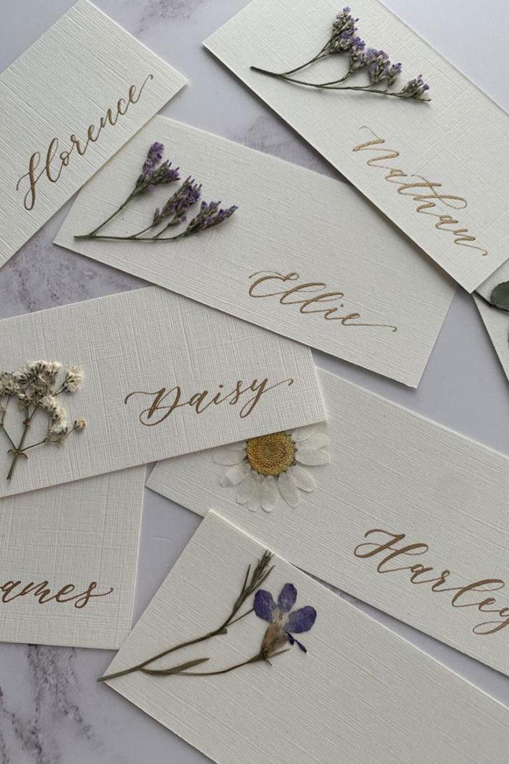 YouHadMeAtHelloLTD on Etsy - Pressed Flower Wedding Escort Cards