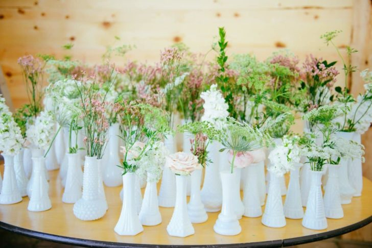 milk glass vases. borrow items from your family and friends to have a more sustainable wedding.