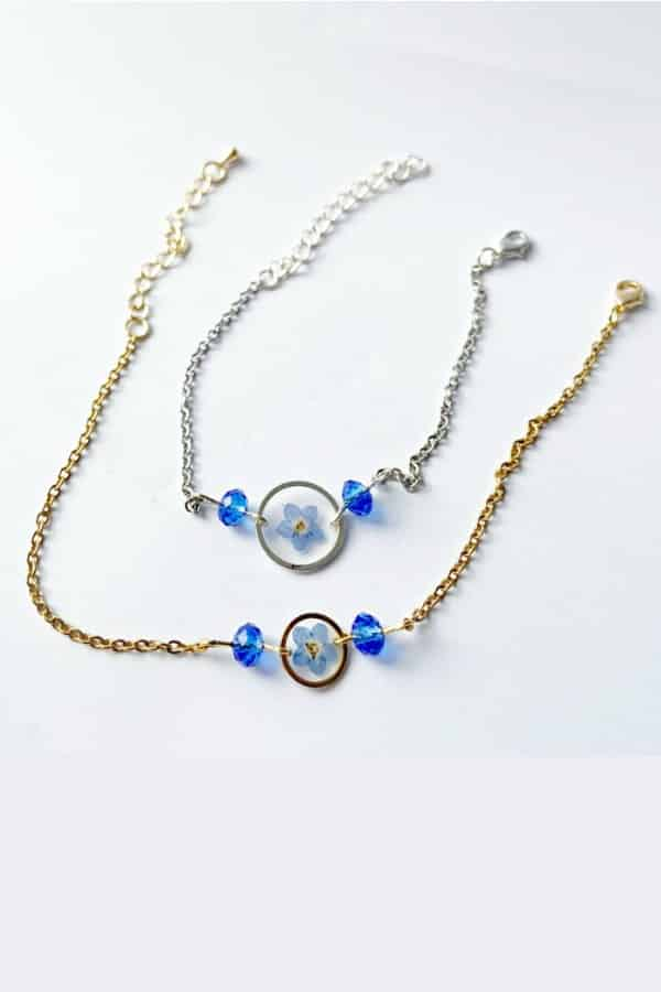Blue Pressed Flower Bracelet By NewJewelleryStory  Real dried forget-me-nots are layered in jewelry grade resin in this dainty bracelet. Choose from silver or gold. Makes a sweet gift for your flower girl.