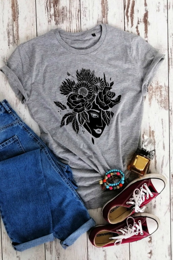 Organic Cotton Flowers Tshirt By UrganicWear  --  Your older flower girls will appreciate this soft and comfy organic cotton t-shirt with a flower motif. It's available in several choices of color. She'll  remember participating in your wedding  every time she wears it.
