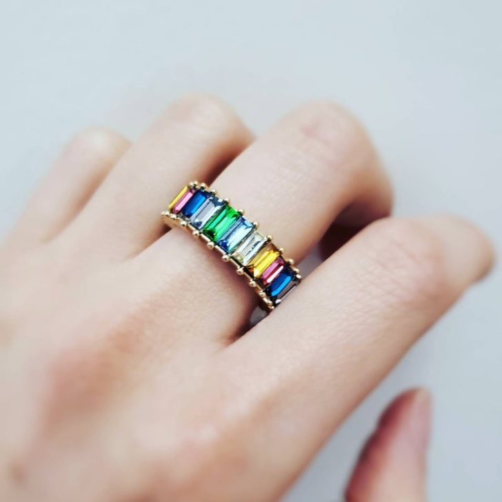 Browse these LGBTQ+ Wedding Accessories and rainbow wedding finds that celebrate love in all its diverse and beautiful colors.  rainbow baguette band