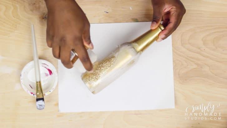 adding glitter to glass bottles for wedding decor