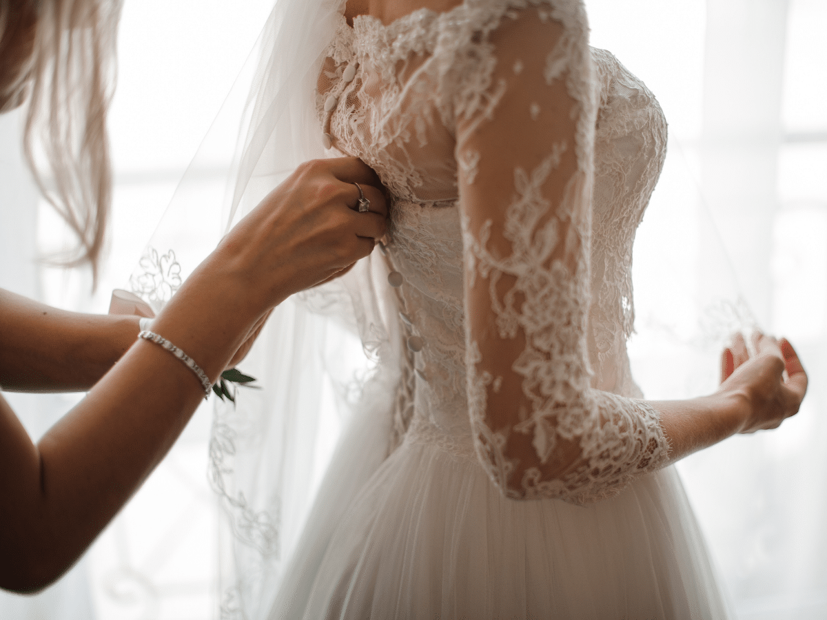 wearing a white wedding dress