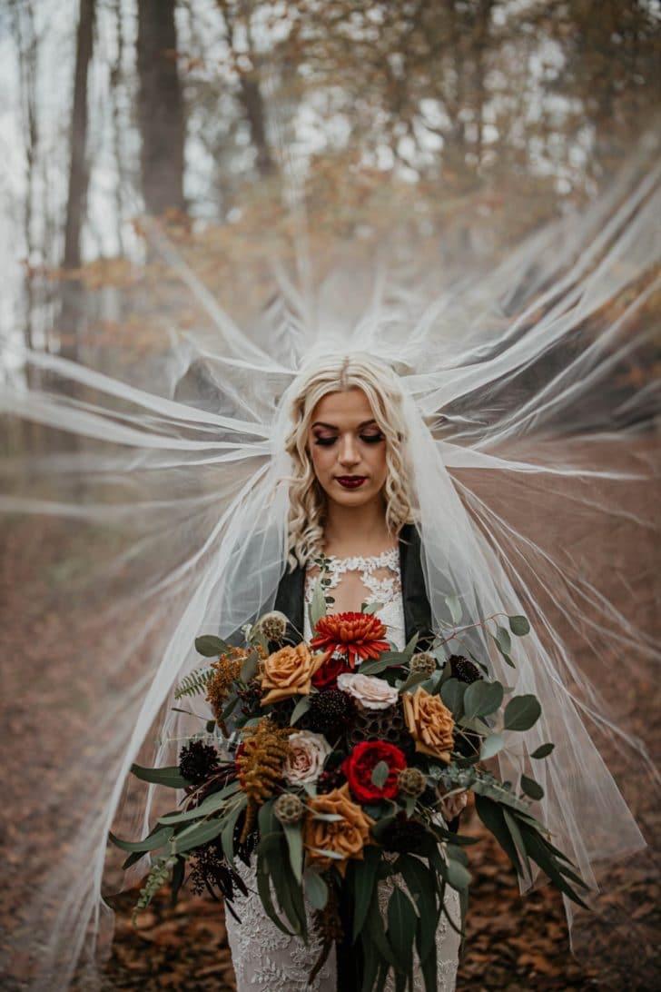 fall wedding - bride in veil - dark moody photography