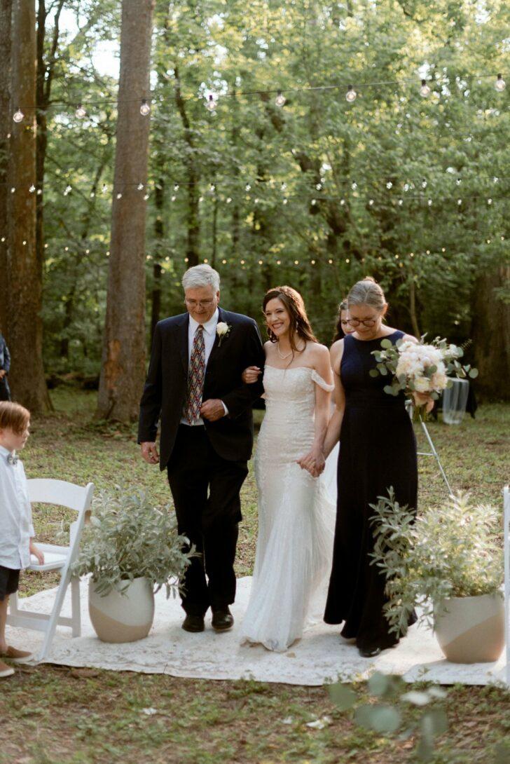 both parents walking the bride down the aisle