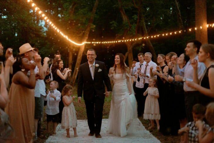 bride and groom - romantic fairytale wedding - outdoor wedding - wedding in the woods - wedding exit
