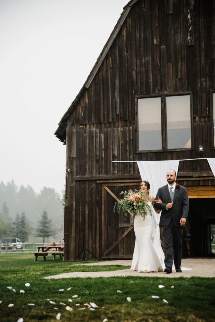 barn wedding - bride walking down the aisle