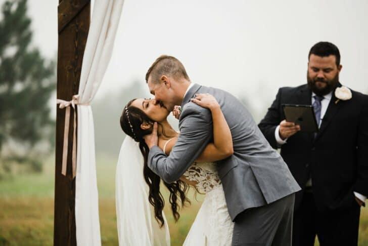 first kiss - bride and groom - wedding kiss