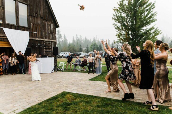 the bouquet toss - bride tossing bouquet