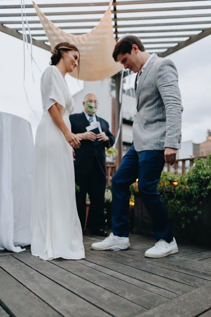 NYC rooftop elopement - smashing the glass
