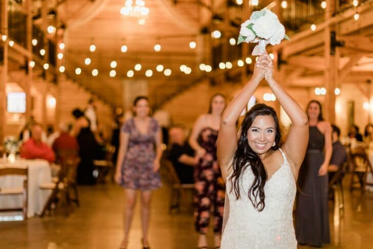 real bride throwing the bouquet - bouquet toss