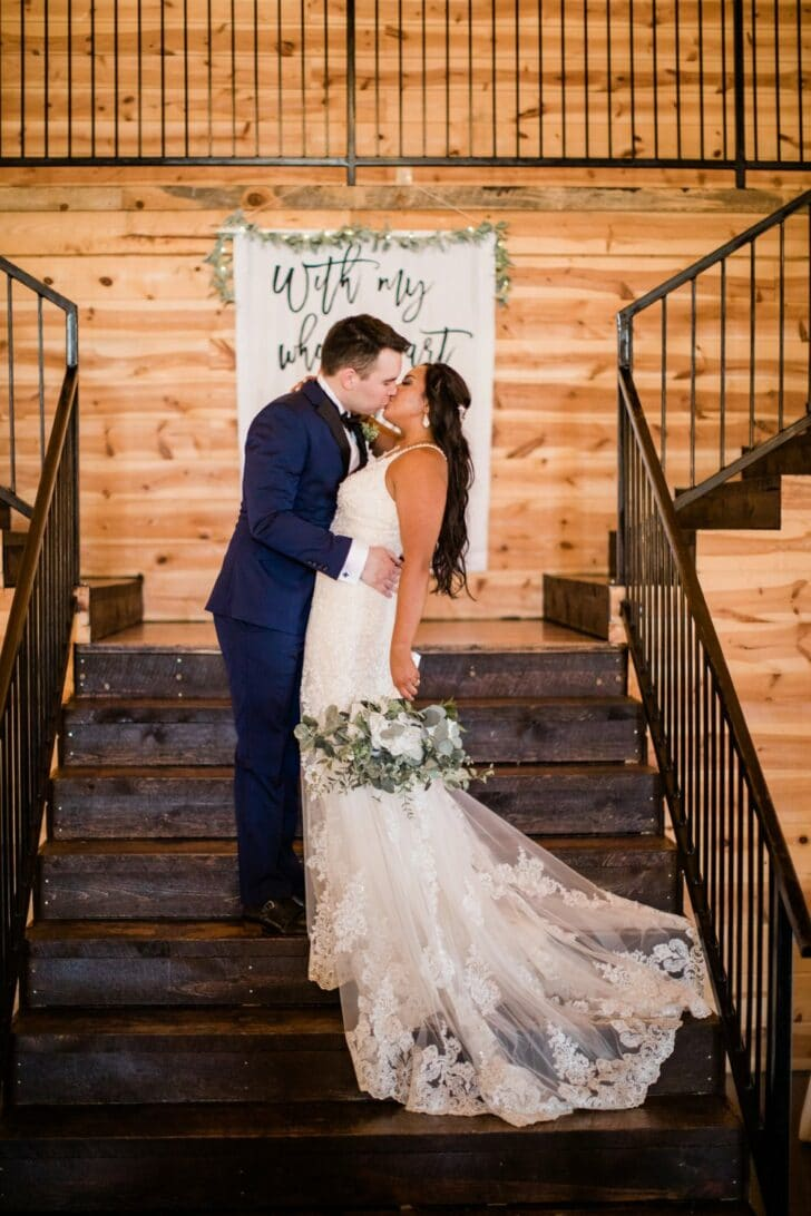 bride and groom on the stairs- DIY sign made with Cricut